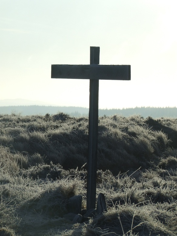 A cross on the subsidiary peak