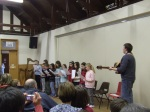 Norrie leads the singers