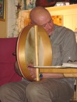 Paul slumped over his Bodhran.