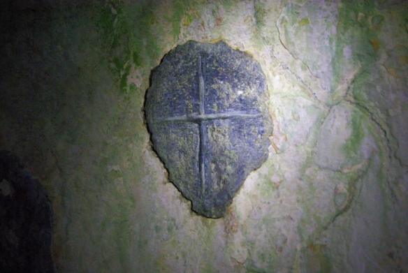 ancient cross carved inside the hermits cave- 7th C