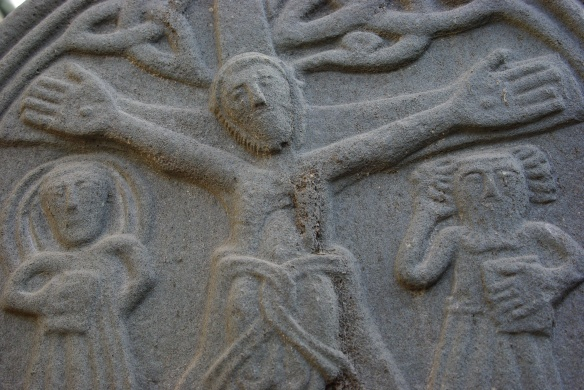 Carved stone cross, crucifixion, detail